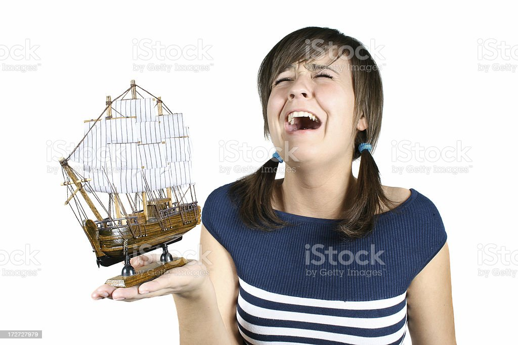 capricious girl with a model of ship stock photo