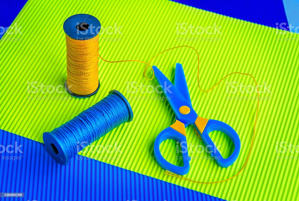 caprone threads, scissors and paper stock photo