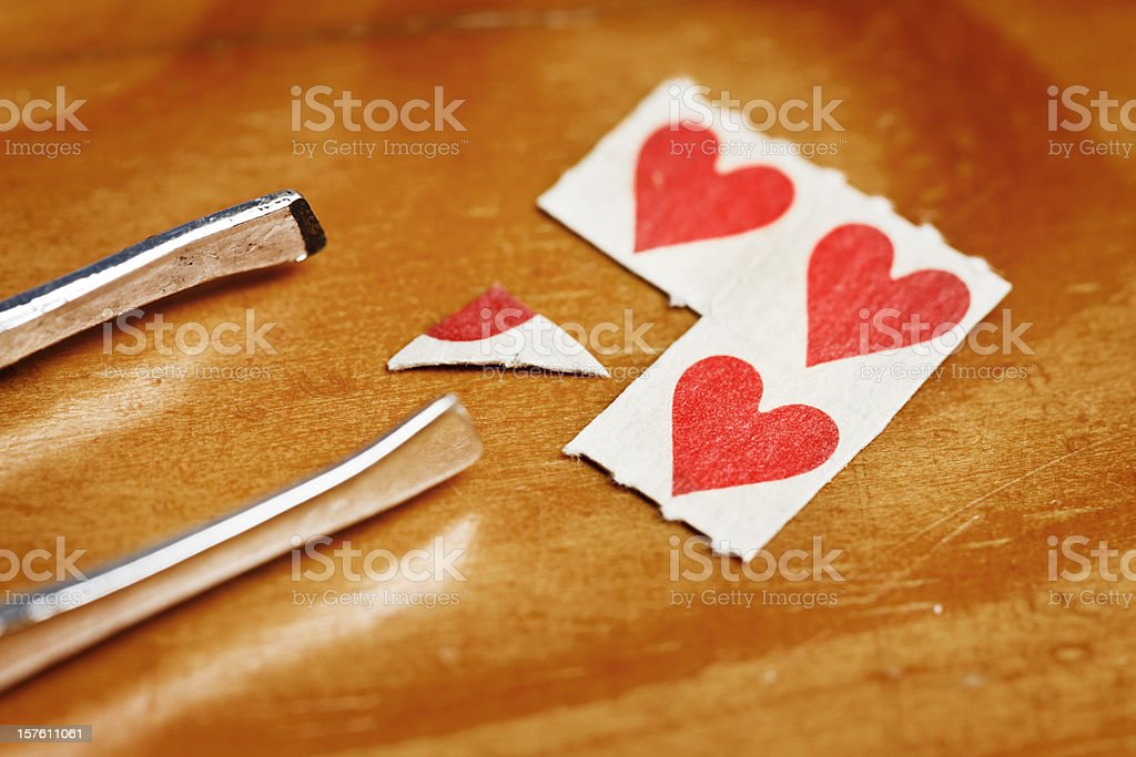 LSD caps and tweezers on wood stock photo