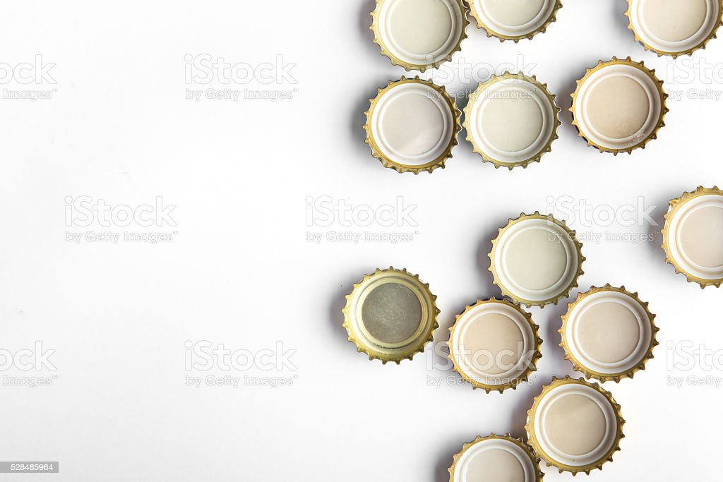 caps of beer on white background stock photo