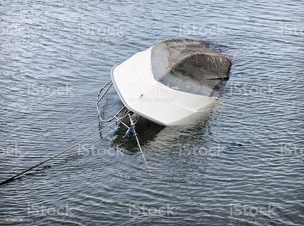 Capsized Boat Sinking stock photo