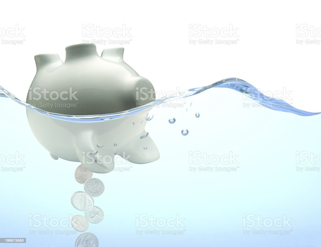 Capsized Piggy Bank stock photo