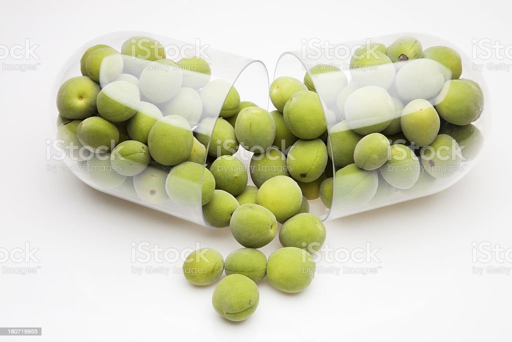capsule and plum royalty-free stock photo