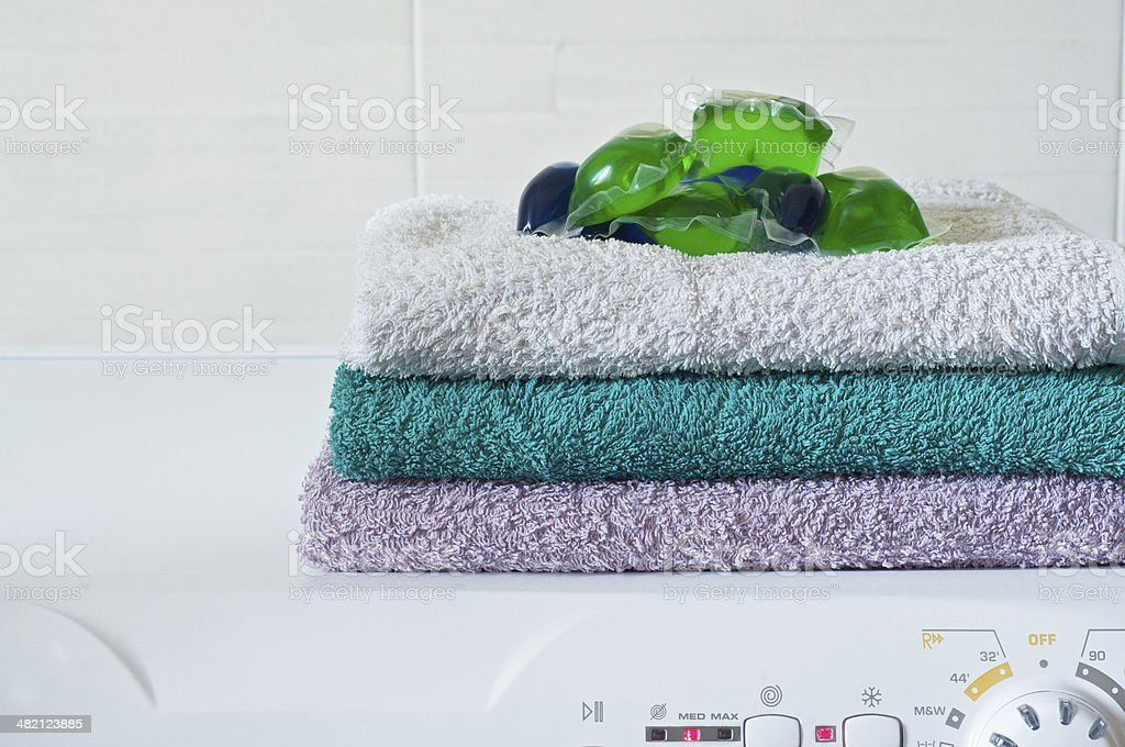 Capsule detergent on top of washing machine stock photo
