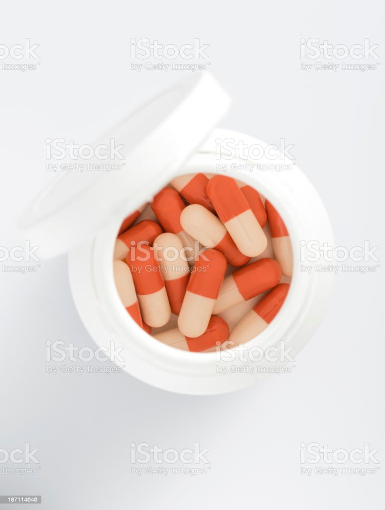 Capsule pills in bottle royalty-free stock photo