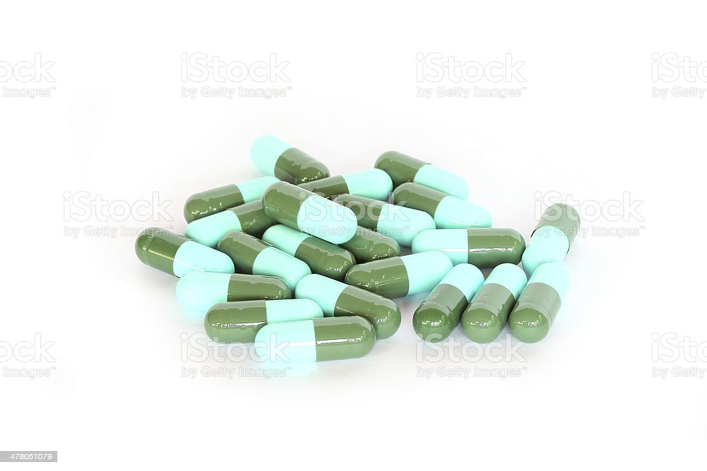 Capsule pills on white background royalty-free stock photo