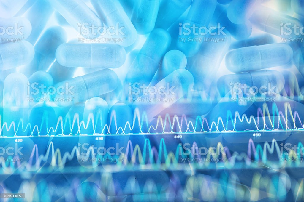 capsule pills with DNA sequence peaks in the back stock photo