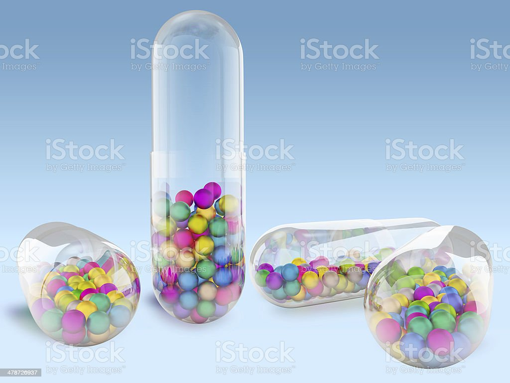Capsule with colored balls stock photo