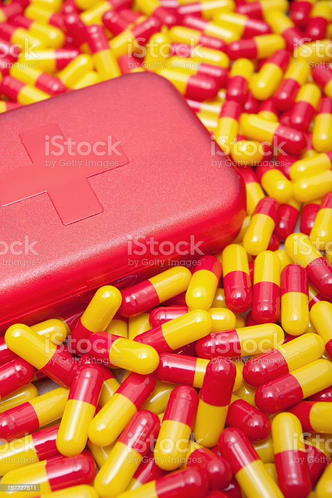 Capsules and Medicine box background royalty-free stock photo