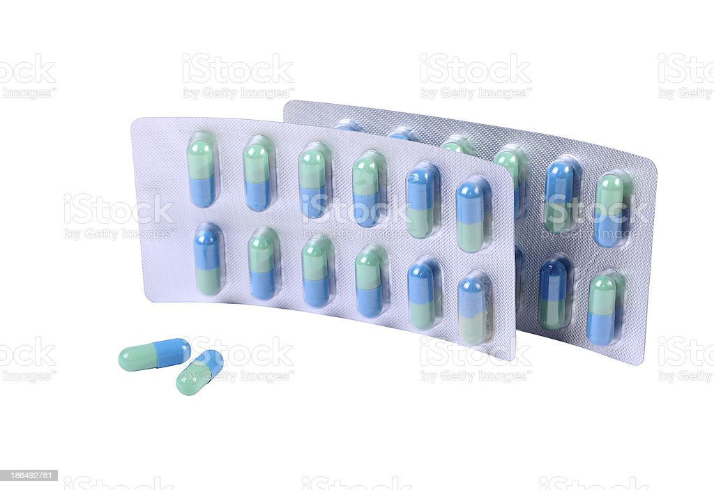 Capsules and two pills container royalty-free stock photo