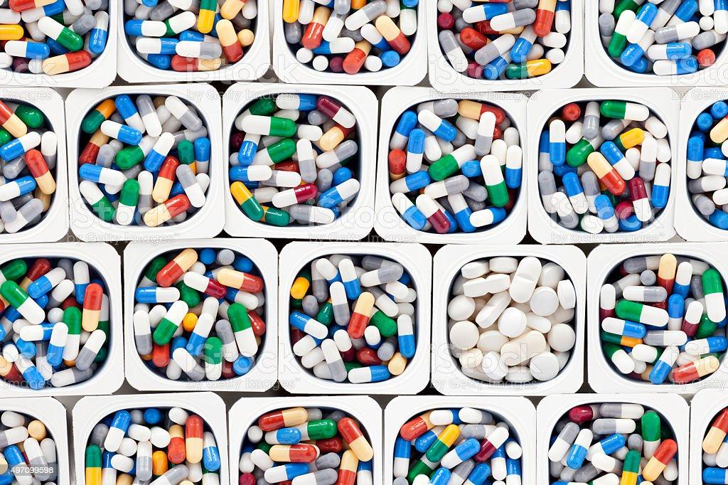 Capsules and white pills stock photo