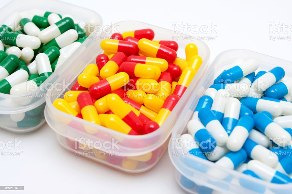 Capsules in Pill Box isolated royalty-free stock photo