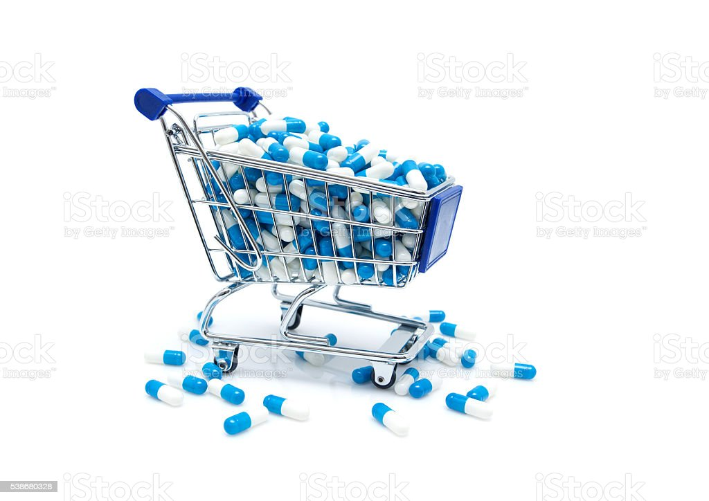 Capsules in the Shopping Cart isolated on white background stock photo