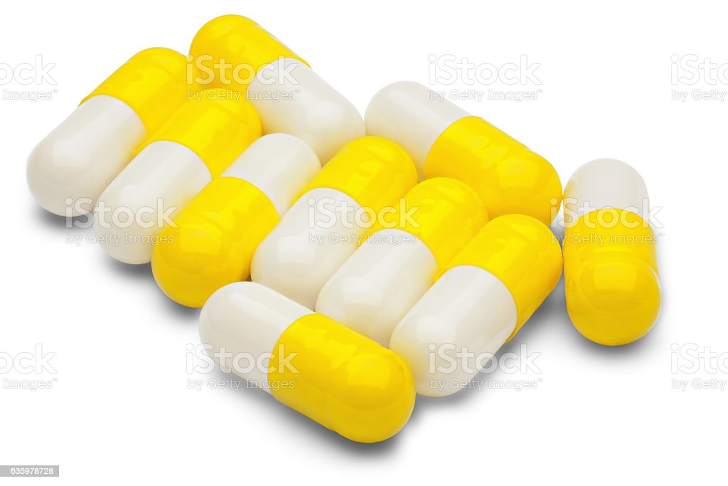 Capsules of yellow medical supplement product isolated stock photo