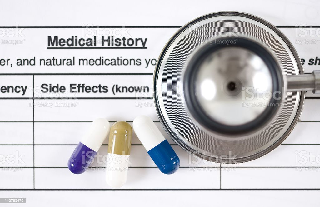 Capsules, stethoscope and Medical Form stock photo