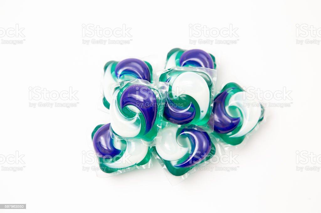 Capsules with laundry detergent on a white background. stock photo
