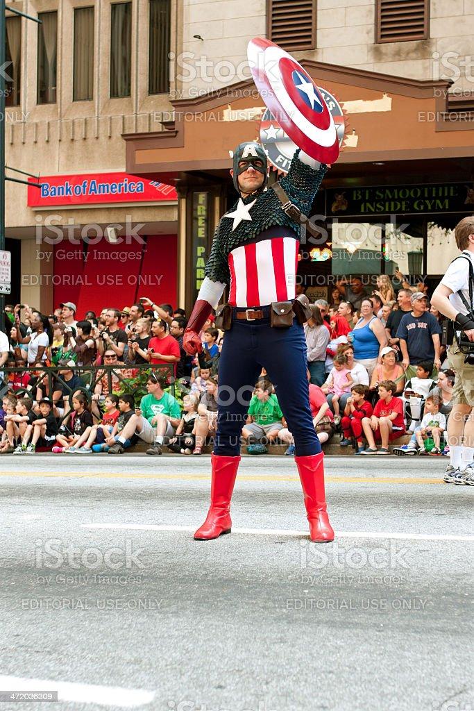 Captain America Salutes Spectators At Atlanta Dragon Con Parade stock photo