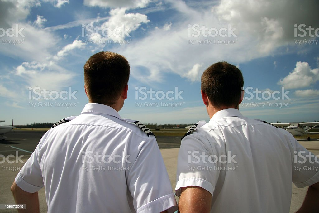 Captain and co-pilot royalty-free stock photo