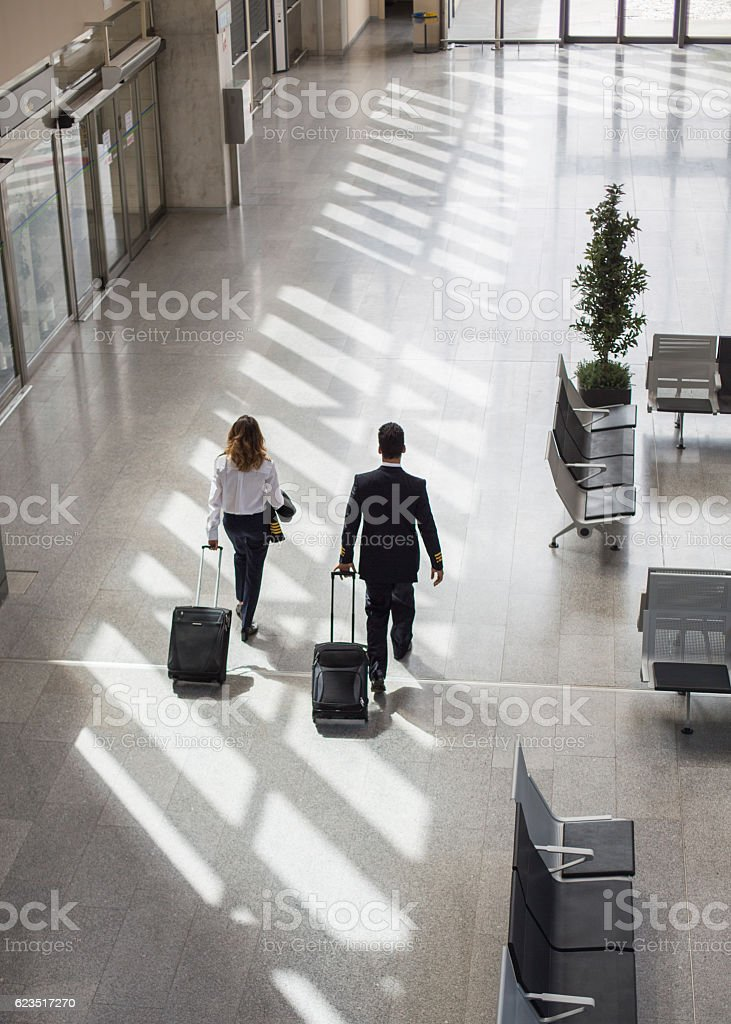 Captain and Pilot walking through airport terminal stock photo