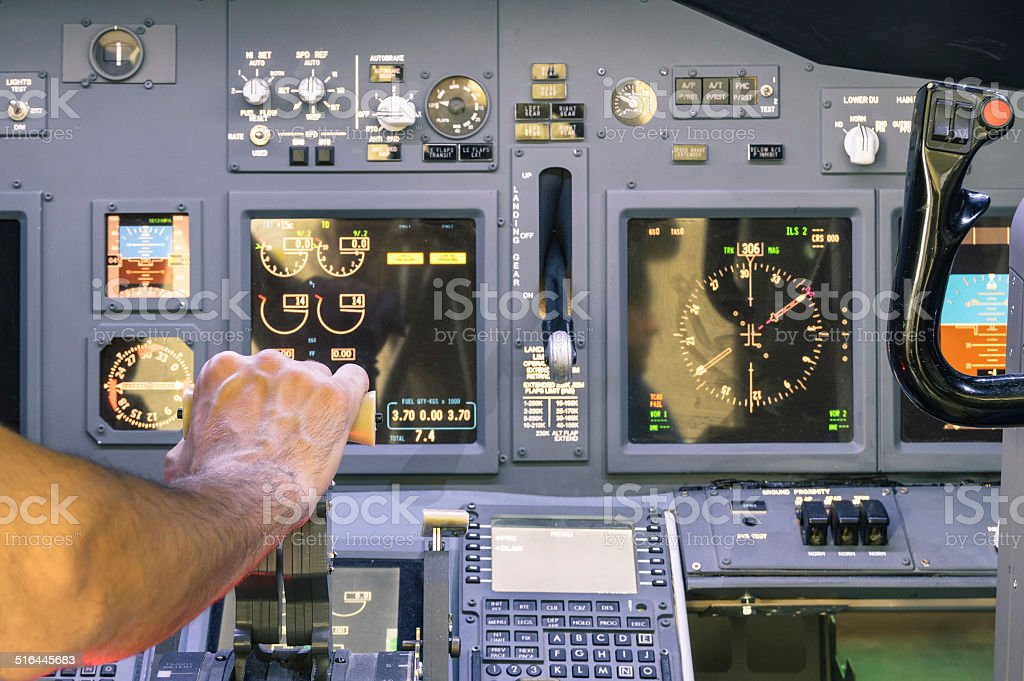 Captain hand accelerating on the throttle in commercial airliner stock photo