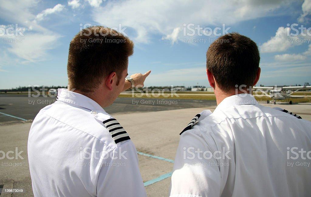 Captain showing copilot royalty-free stock photo