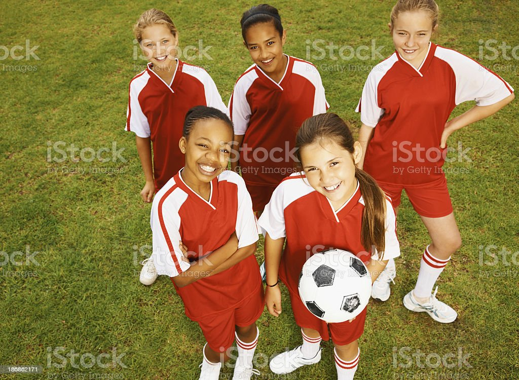 Captain with her team standing together royalty-free stock photo