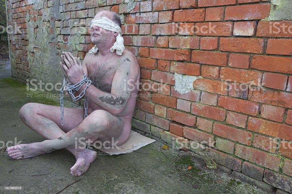 Captive At Prayer royalty-free stock photo