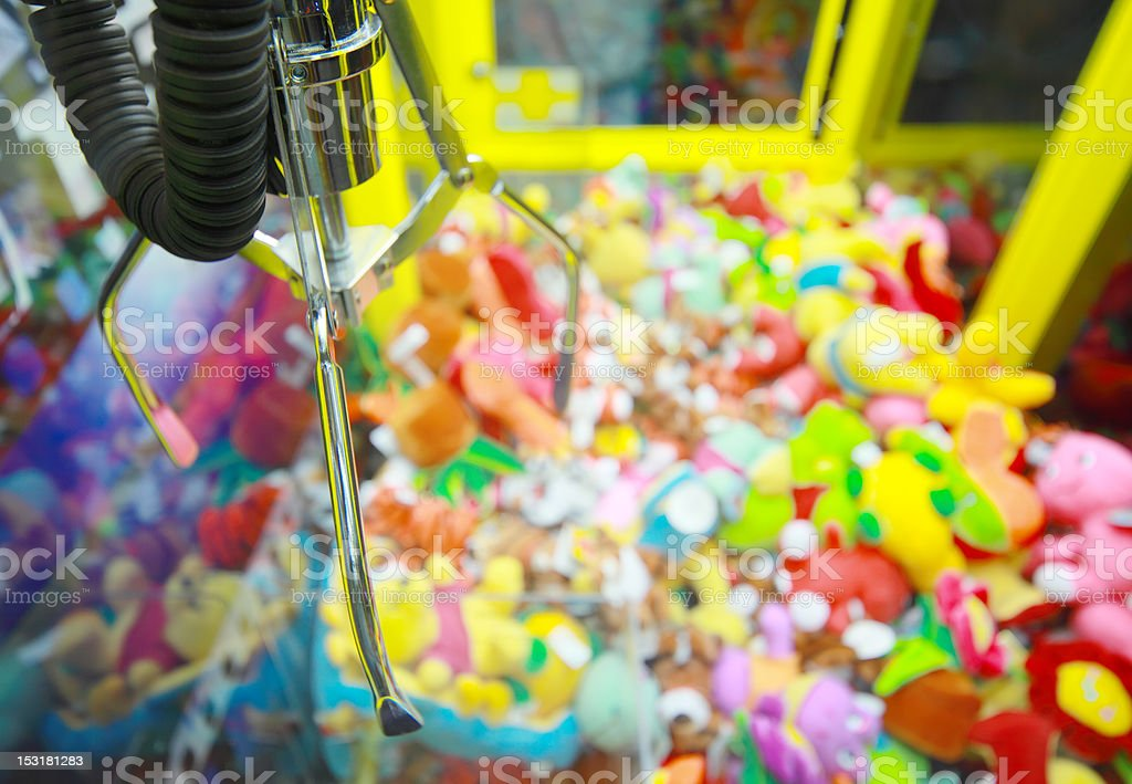 Capture device on background of toys in arcade machine stock photo