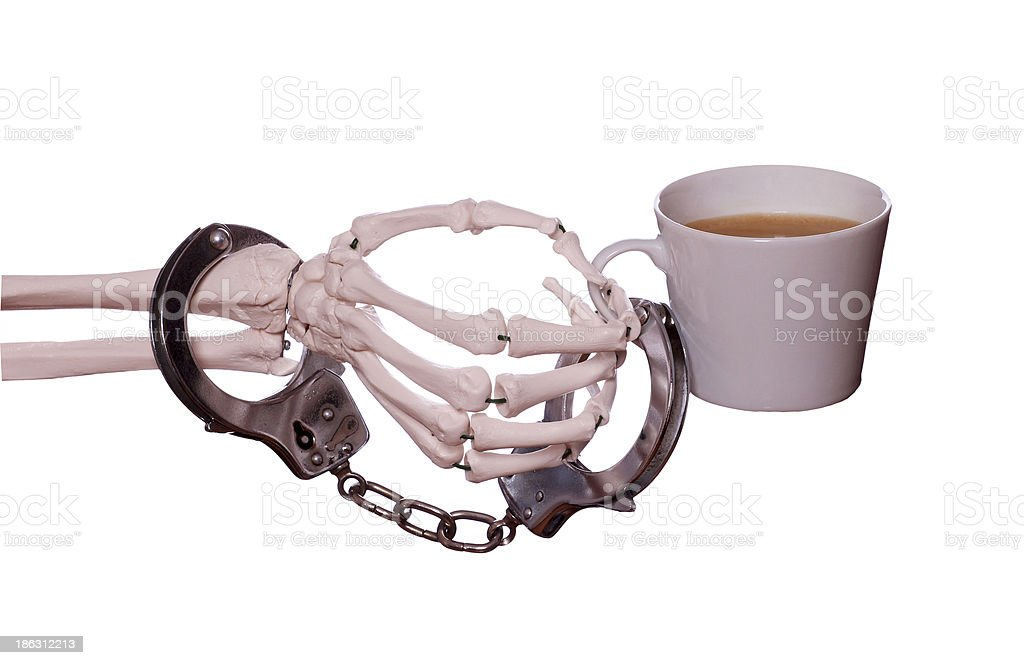 captured coffee with handcuff on skeleton hand royalty-free stock photo
