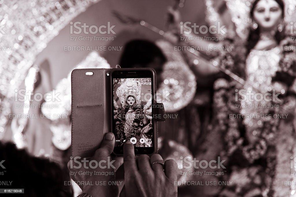 Capturing goddess durga in mobile stock photo