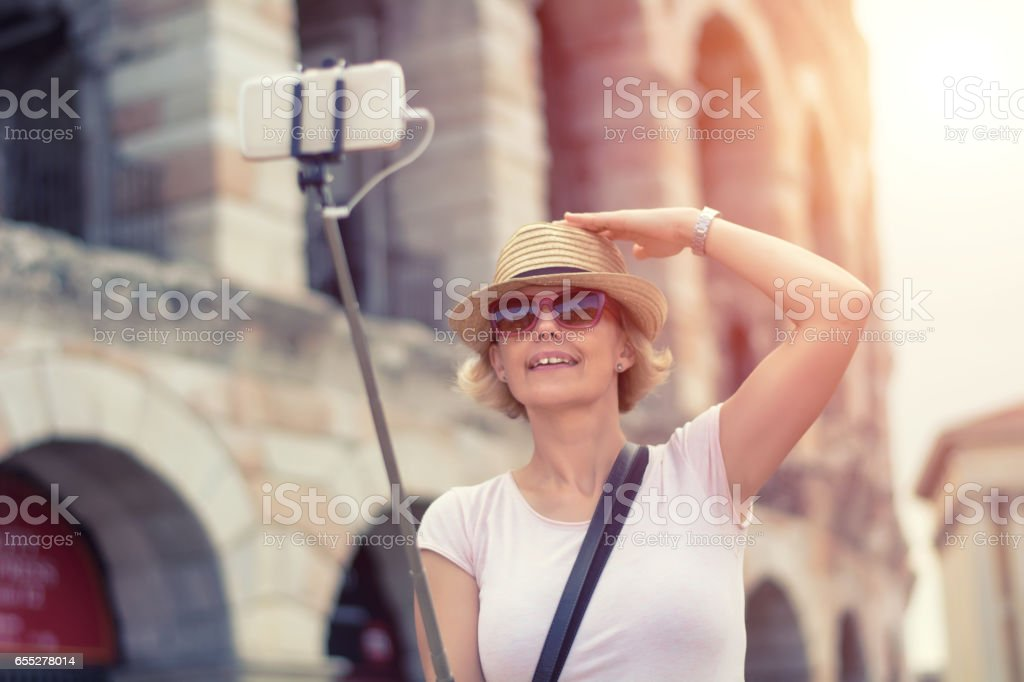 Capturing her travel experience stock photo