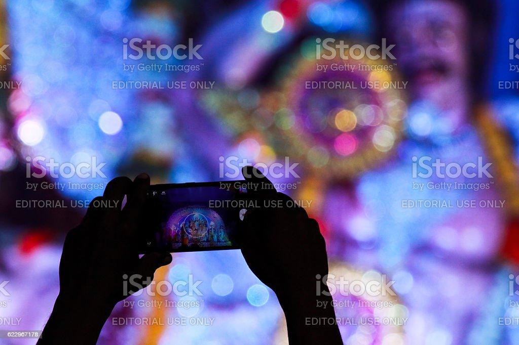 Capturing idol of goddess durga in mobile stock photo
