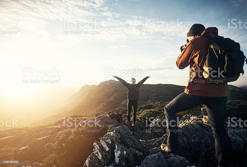 Capturing memories on the mountain stock photo