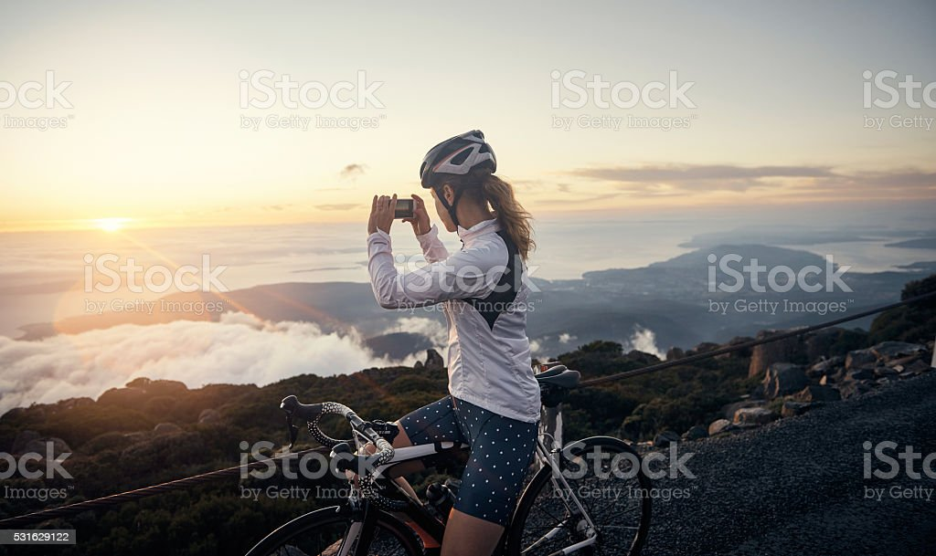 Capturing the moment she conquered the mountain stock photo