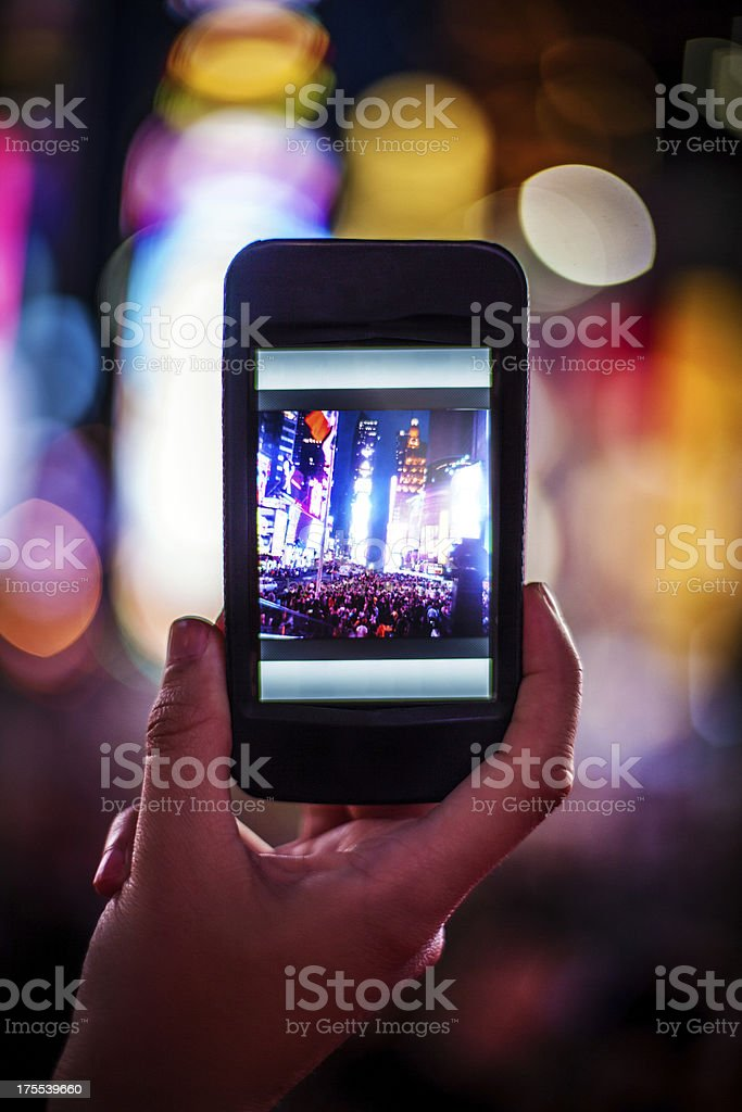 Capturing the moment with a smartphone royalty-free stock photo
