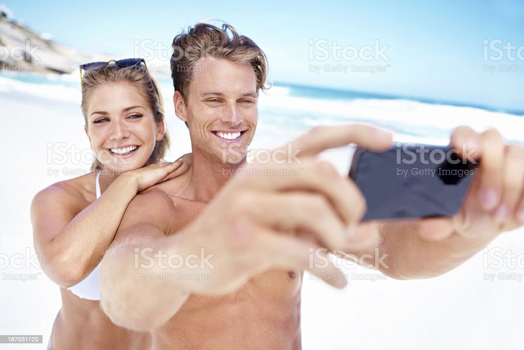 Capturing their day at the beach royalty-free stock photo