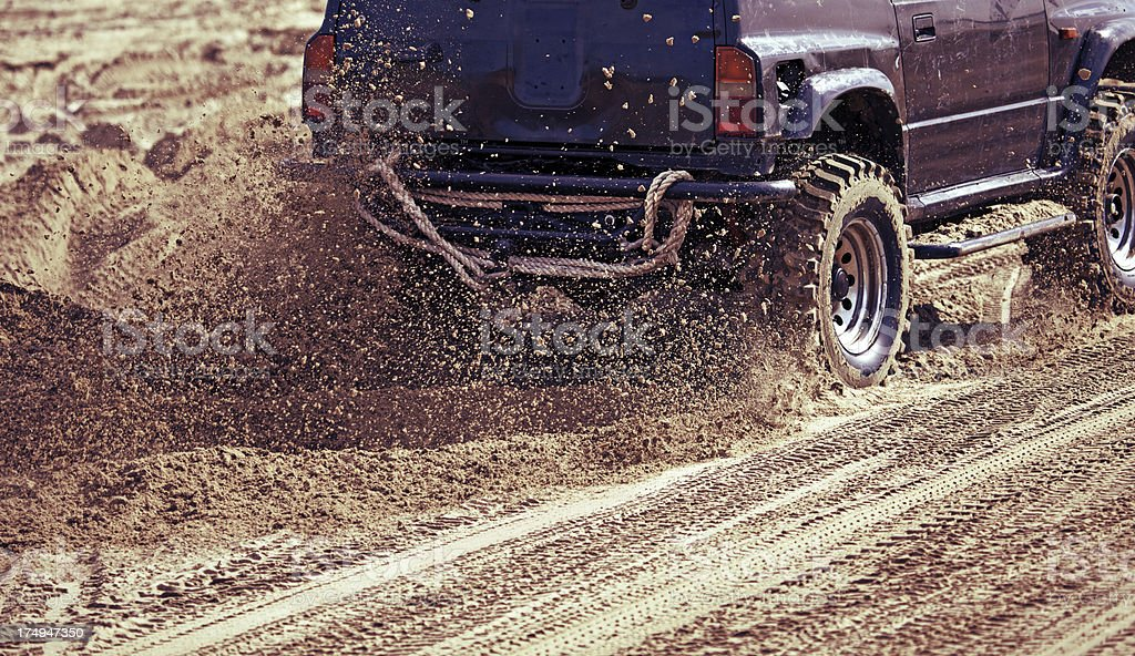 car accelerating on sand royalty-free stock photo