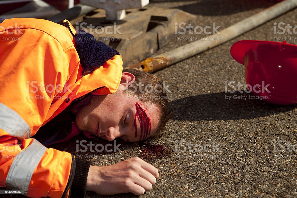Car accident and road construction. Injured person on asphalt. stock photo