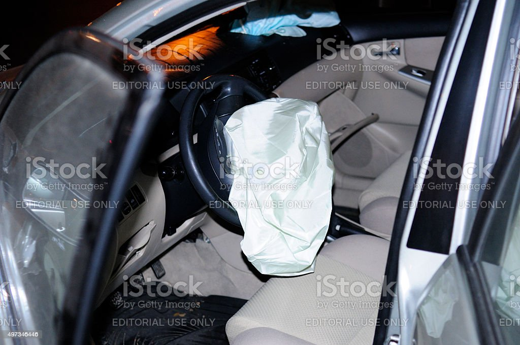 Car accident, opened driver's and passenger's airbags stock photo