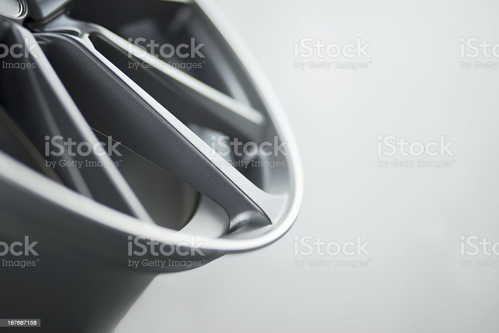 Car alloy wheel with copyspace grey background stock photo