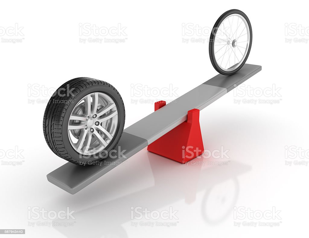 Car and Bike Wheels Balancing on a Seesaw stock photo
