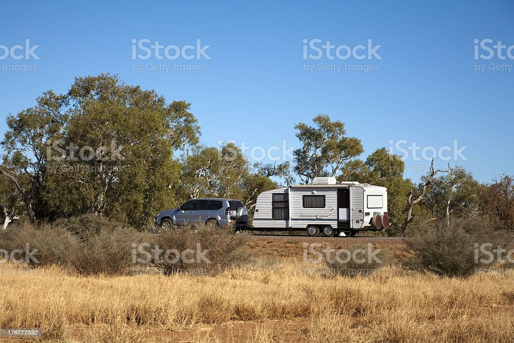 Car and Caravan Travelling in the Australian Bush royalty-free stock photo