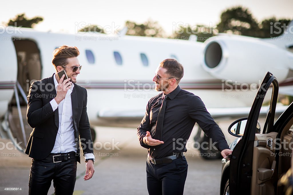 Car and driver waiting for famous person at the airport stock photo
