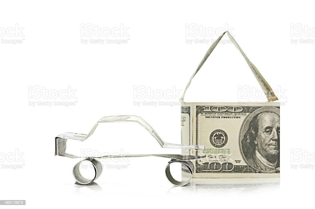 Car and  house made of Dollars stock photo