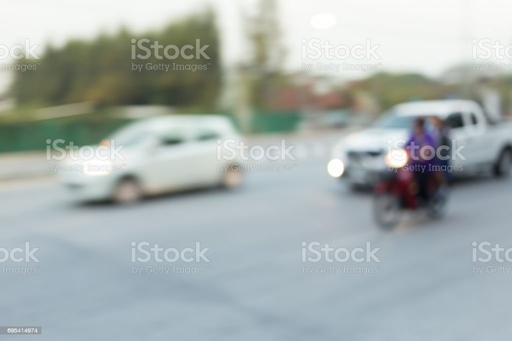 car and motorcycle driving on road with traffic jam in the city, abstract blurred background stock photo