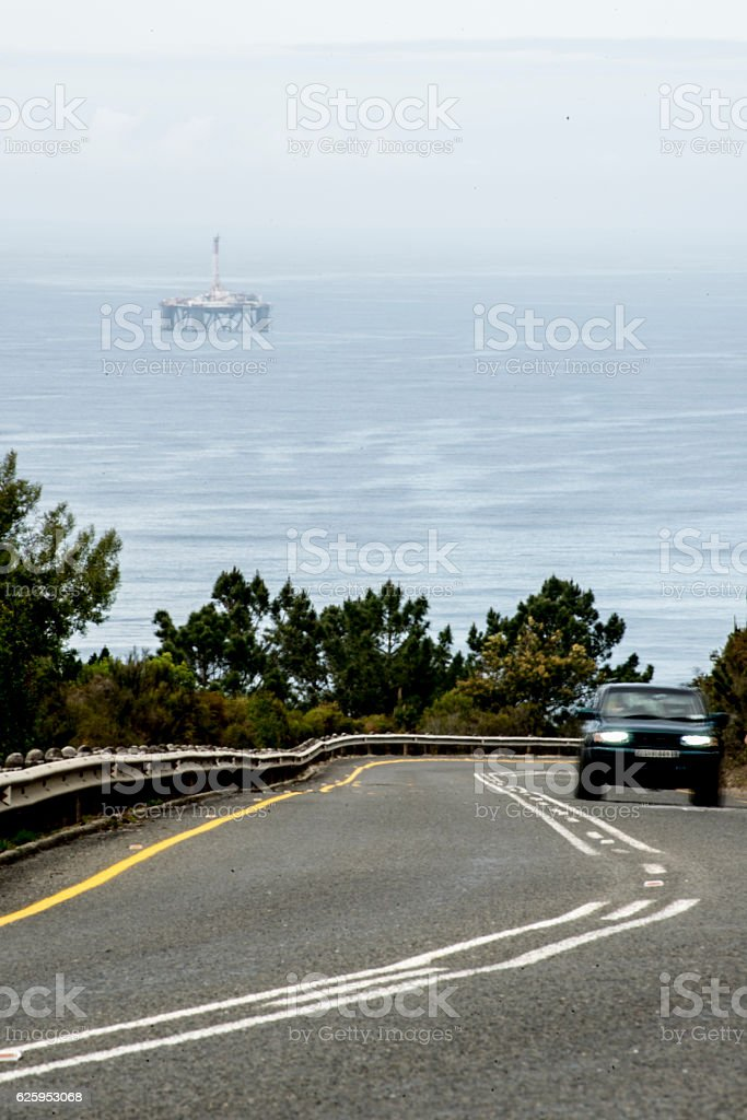 Car and Oil Drill Platform stock photo