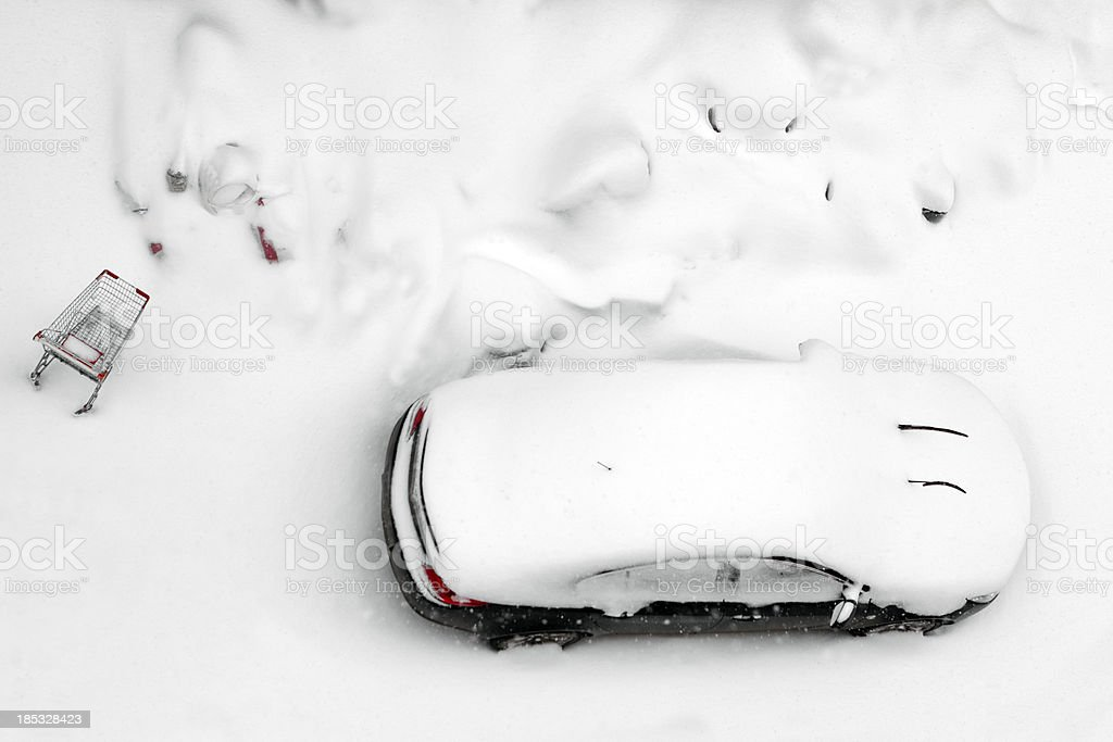 Car and shopping cart snow in Istanbul. royalty-free stock photo