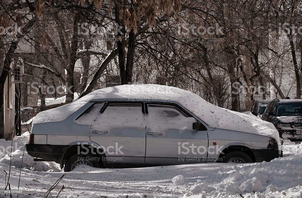 Car and street under snow. stock photo