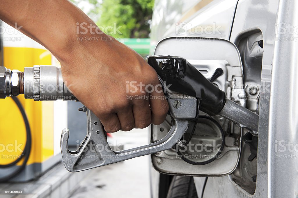 Car at gas station being filled with fuel. stock photo