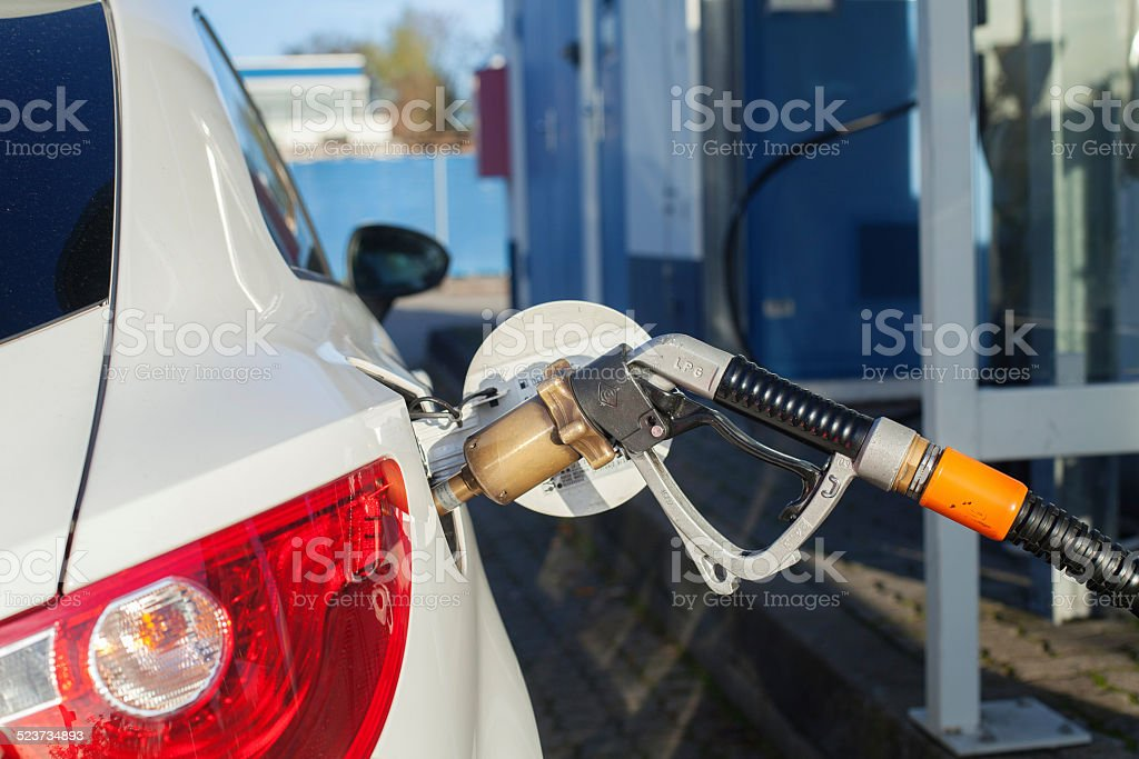 Car at gas station stock photo
